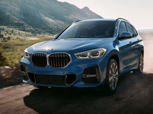 BMW X1 driving on a road