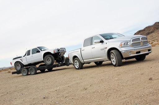 RAM 1500 towing a vehicle