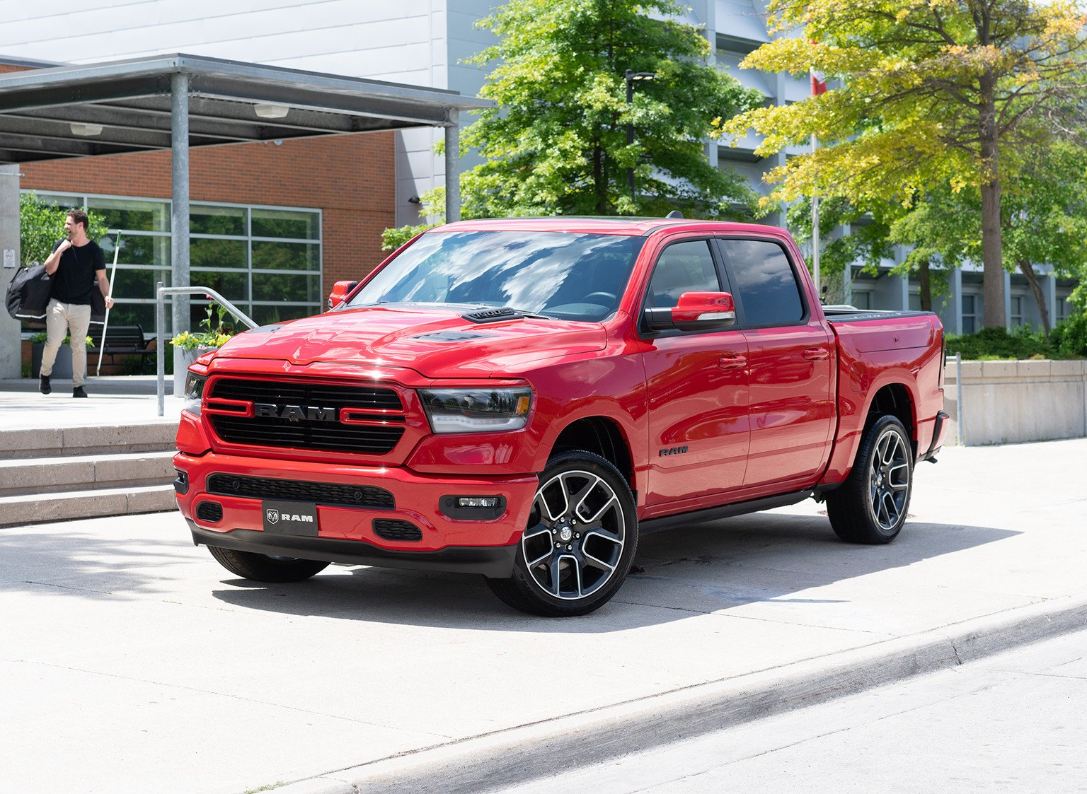 2021-ram-sport-mosaic-canadian-red-parked-outside-building